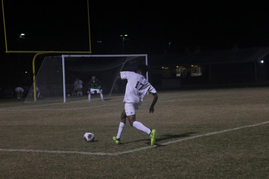 Solomon Browne ('18) moves the ball up the field in their game against Blake High School.