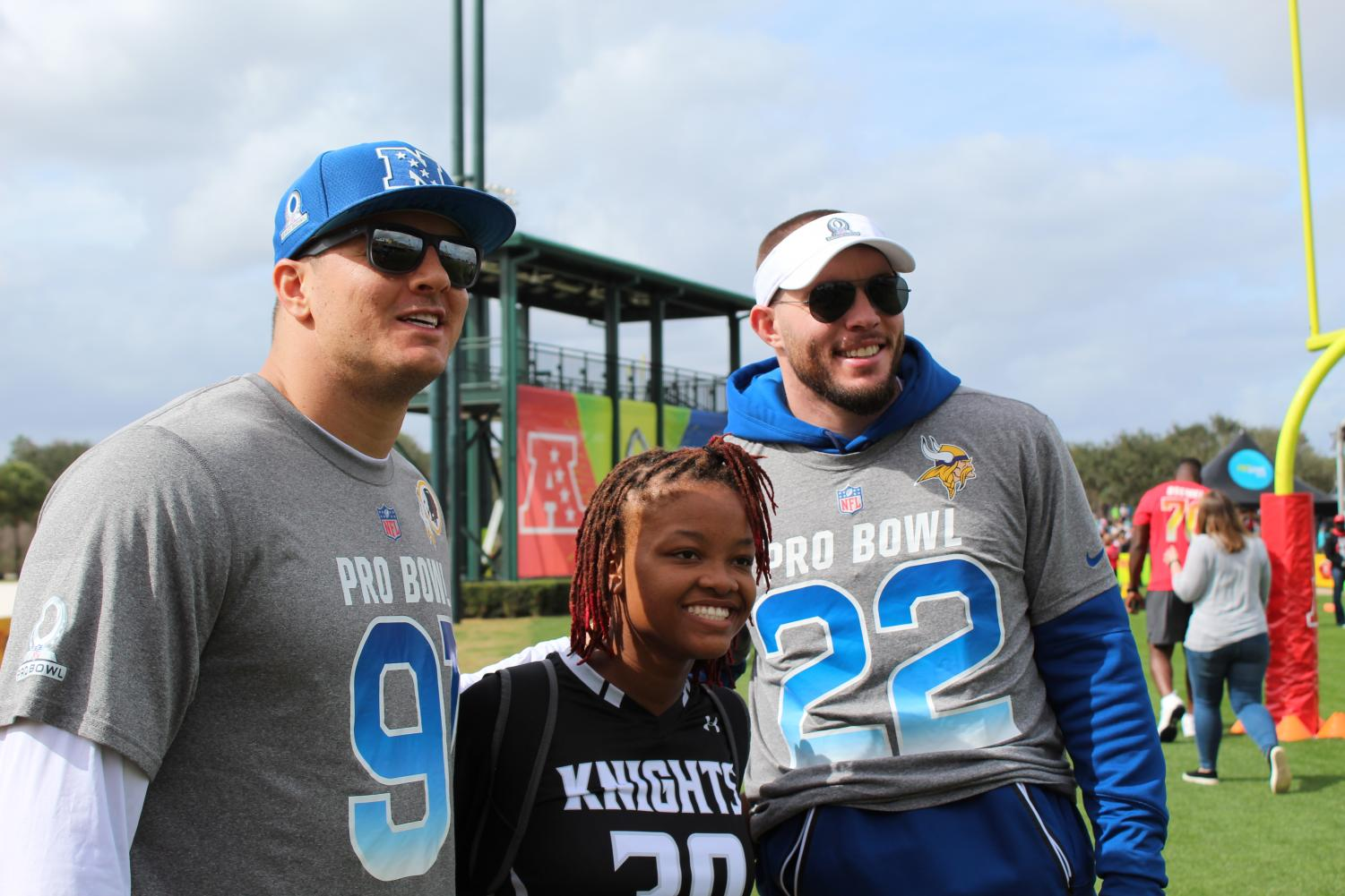 Safety N'Dea Fitzgerald ('21), standing with NFL Pro Bowl players Ryan Kerrigan and Harrison Smith.