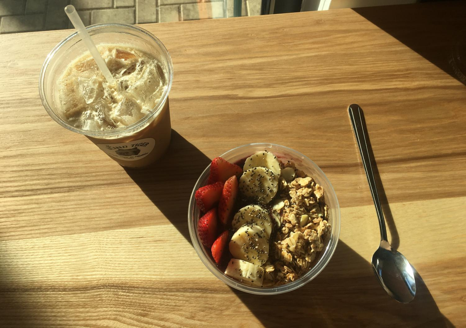 Staffer Nathalie Monroy reviewed the Blind Tiger on South Howard and ordered the Café Caramel iced latte and Original Acai Bowl.