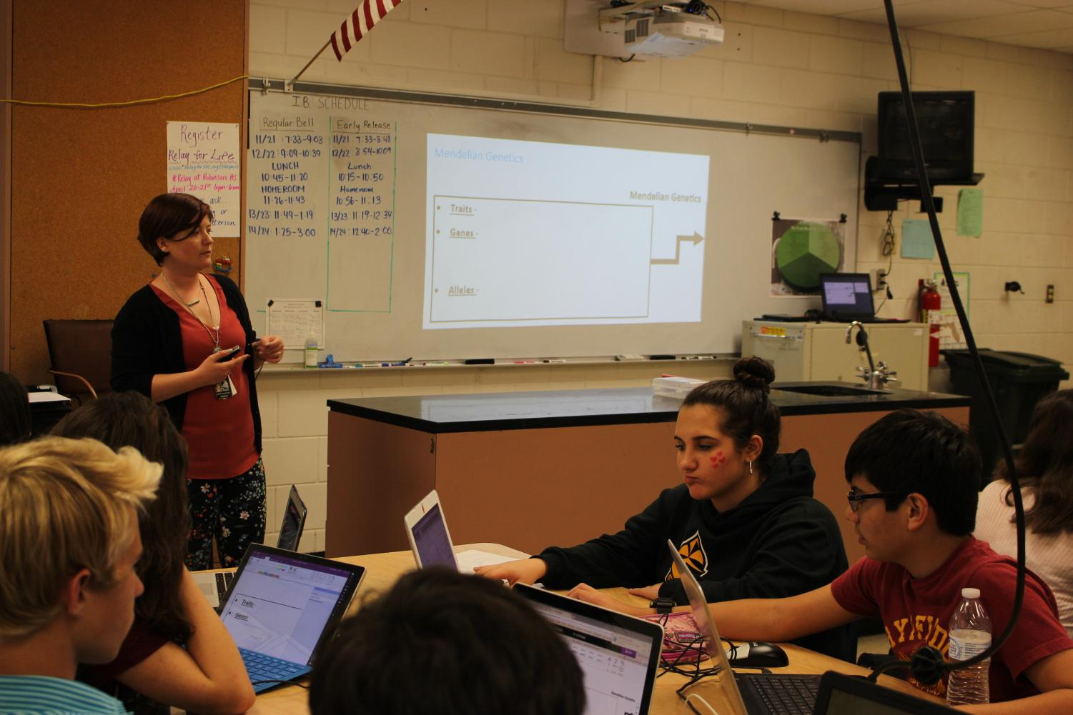 Sanford lectures the class on the day's lesson in her new position as the IB biology teacher.