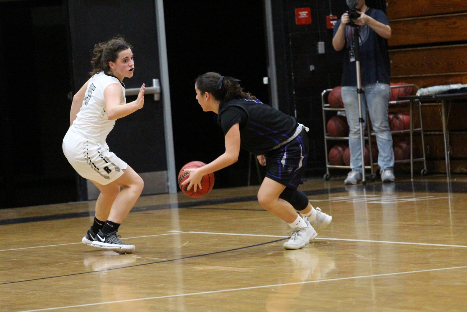 Emily Kemp guards Spoto's leading scorer as the Lady Knights go on to claim the district title on Wednesday, Feb. 7.