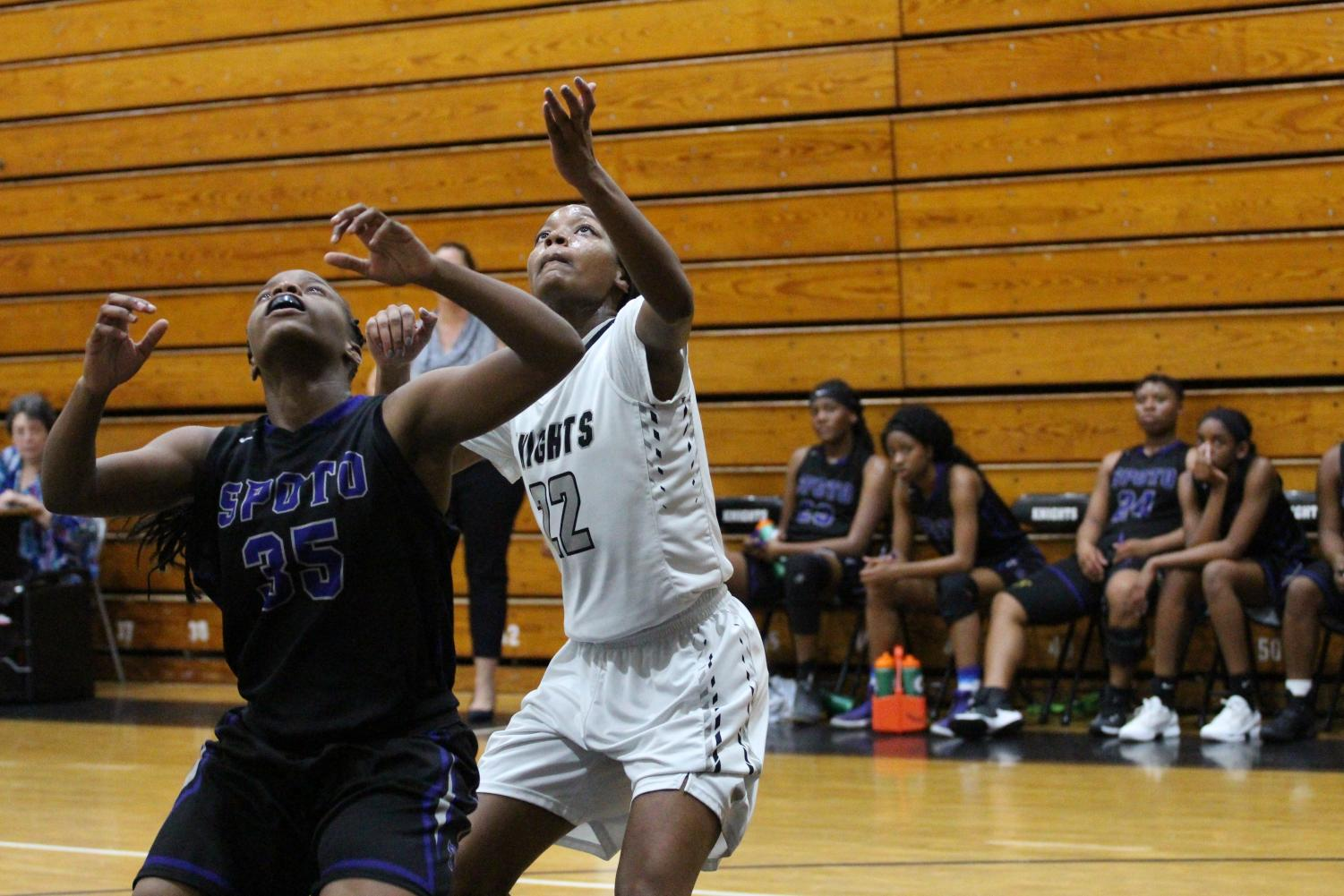 Girls basketball captain Christiana Rolack ('18) goes up for a rebound while plaing Spoto in the district finals on Wednesday, Feb. 7.