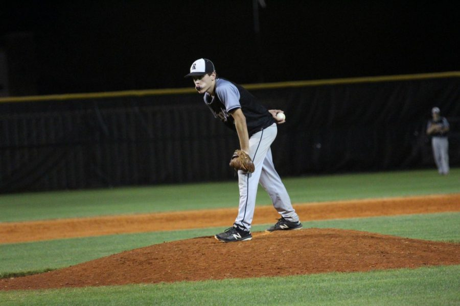 Closing pitcher Paul Jennewein ('20) winds up to pitch against Plant on Tuesday, Feb. 20.