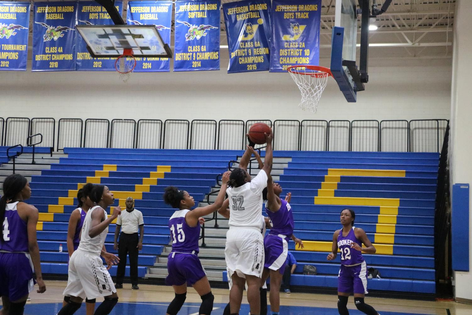 Guard Destiny Thomas  ('19) battles for a rebound in the game against Booker's Chellesy Foster  during the Knights 59-49 win in the Regional Semifinal game Feb. 20.