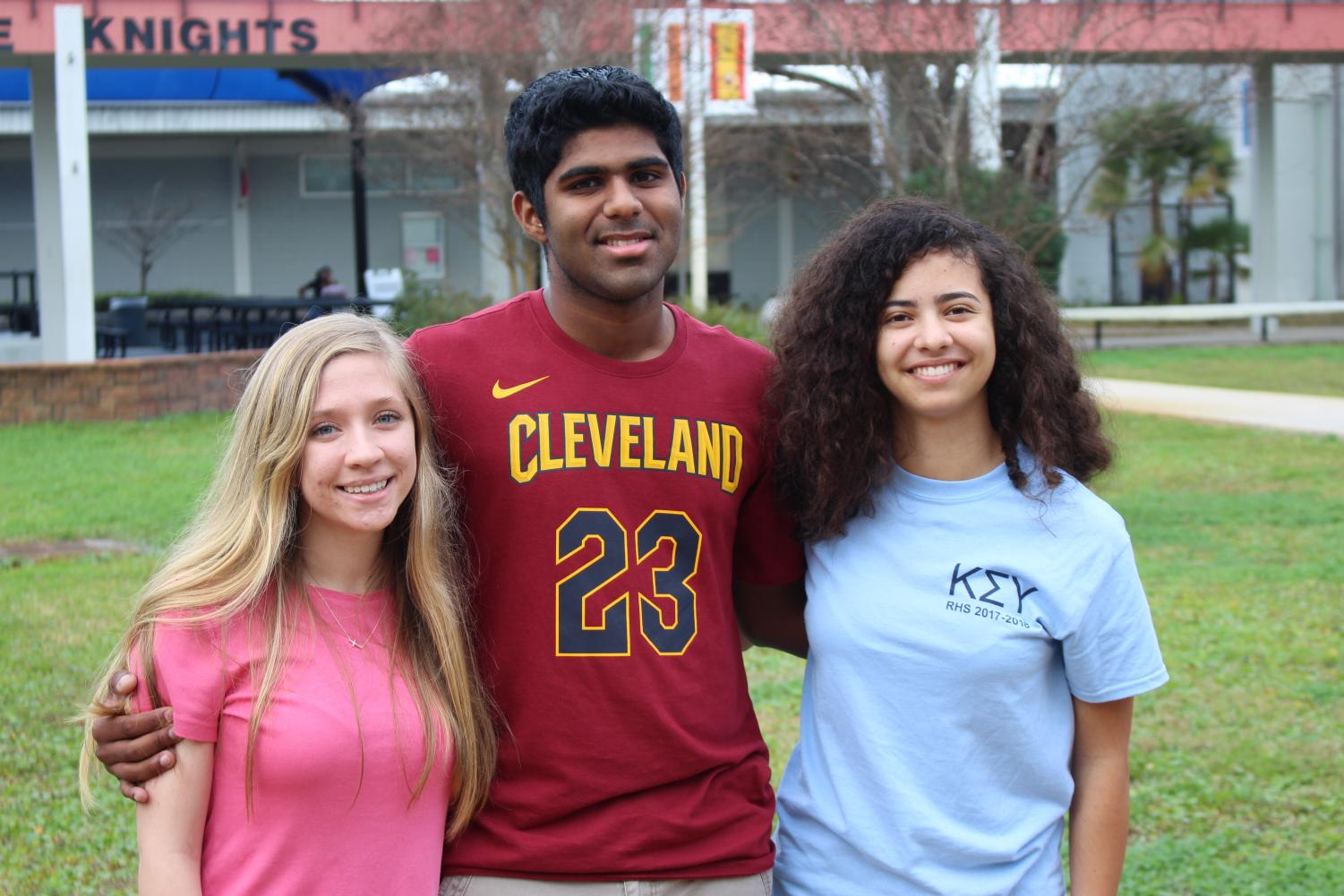 Valedictorian for IB Catherine Johnson, Salutatorian for IB Milin Kurup and Valedictorian for traditional Eve Glenn all smile for a celebratory photo.