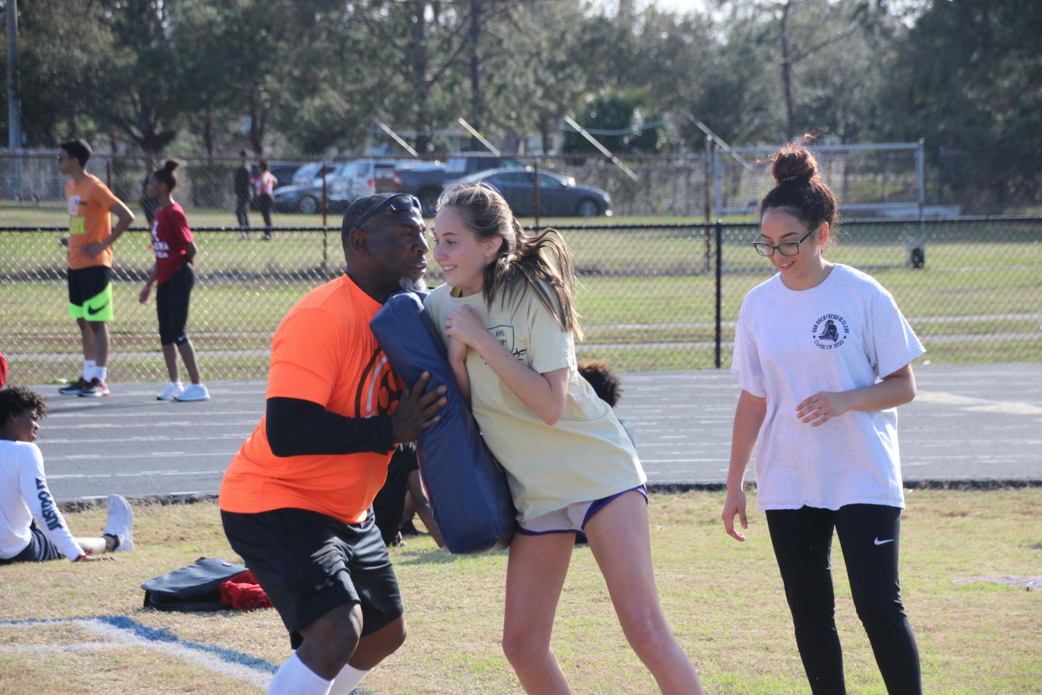 Sadie Jacobson ('21) runs into Earnest Byner during a drill at flag football conditioning.