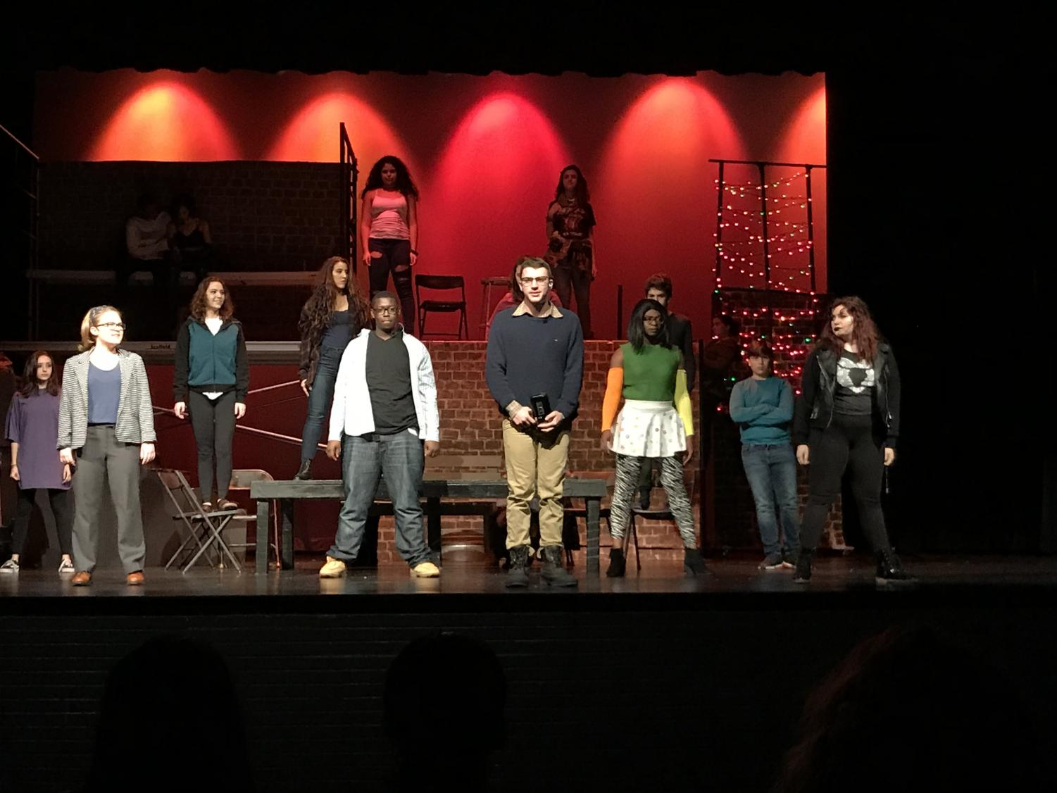 Matthew Reinecke ('18), playing the role of Mark Cohen, leads his cast-mates in another musical number.