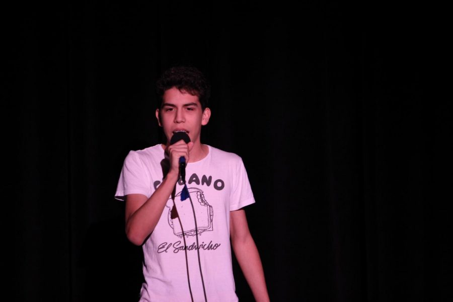 David Navas ('20), band student and talent show performer, sings a song by Little Mix.