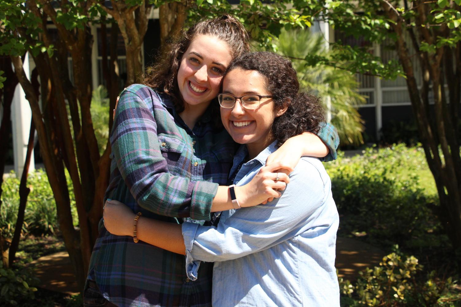 Anna Thomas ('18) (left) and Lillian Martin ('18) (right), the two nominees for Writer of the Year, embrace each other for a photo.
