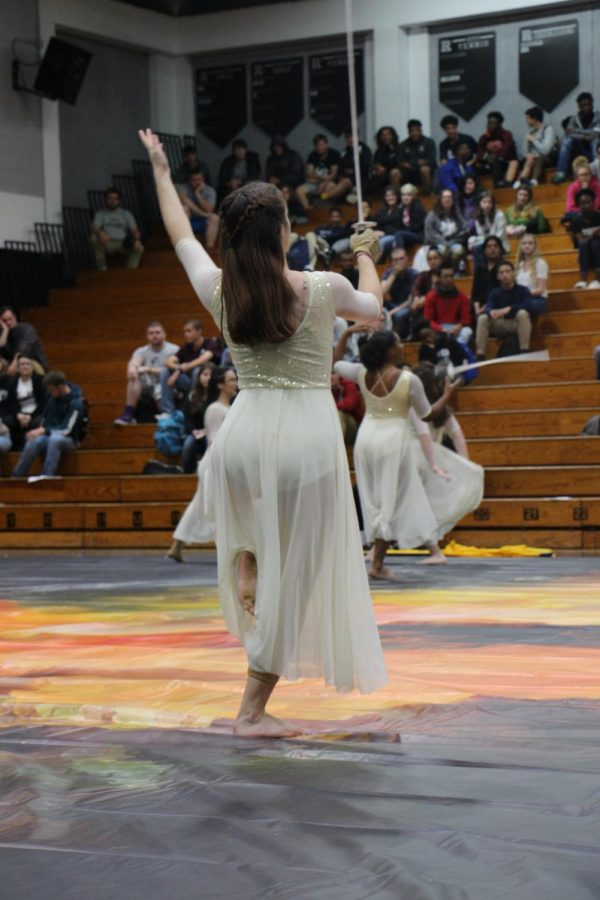 Myla Dell ('19) gracefully dances with her saber in the Starlet's performance.