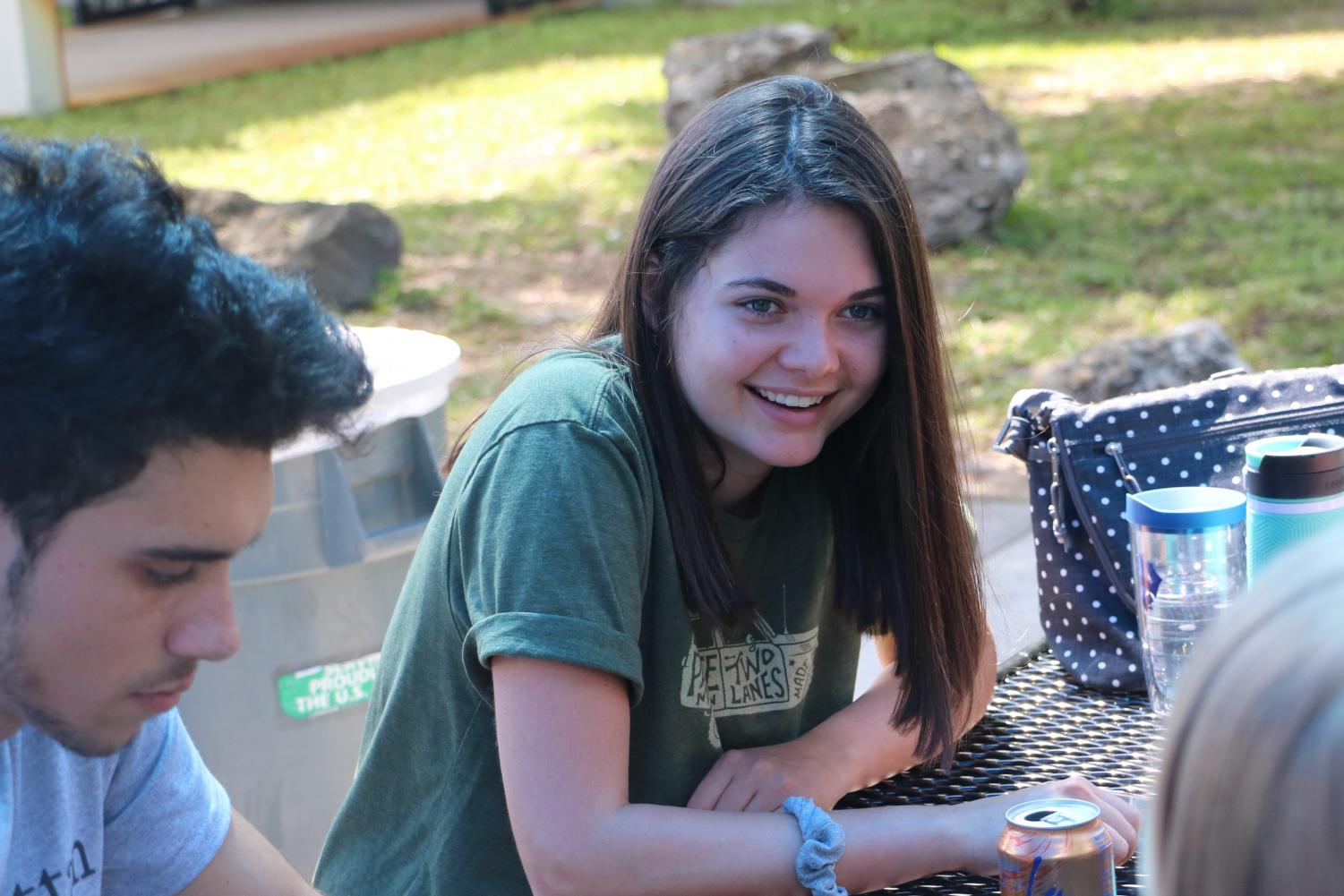 Lane Johansen ('18), recipient of Washington and Lee's Johnson Scholarship, laughs with her friends during lunch.