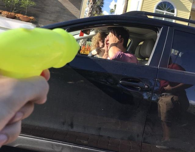Nick Chesney ('18) is eliminated from Water Wars, the senior water gun fight, while in his car. The photo was tweeted as proof of the team's