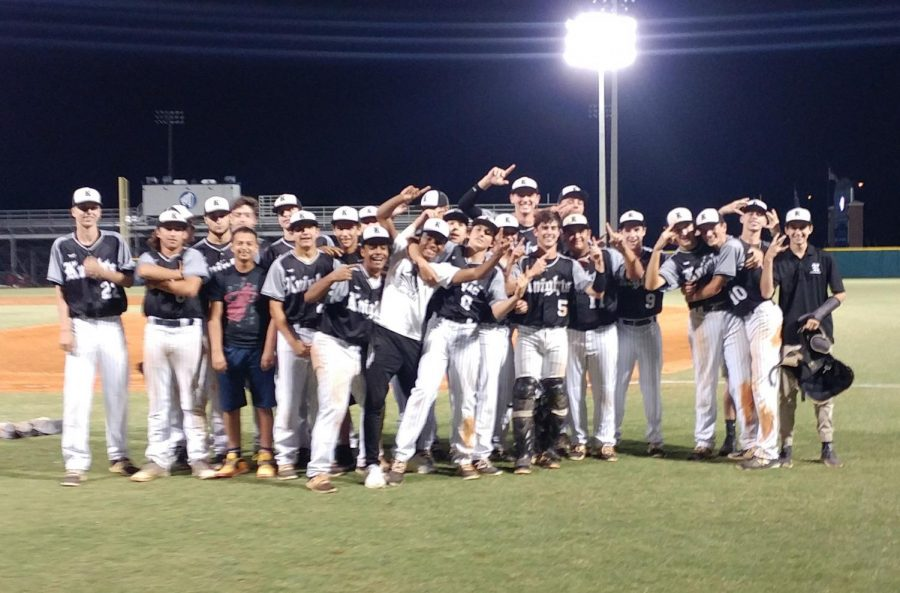 The Knights pose for a team picture after their 5-2 victory over Jesuit.