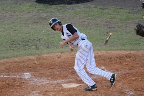 Baseball: Robinson Stifled By Alonso In 4-1 Loss