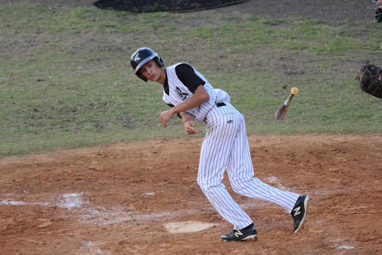 Andrew McMillan ('18) heads to first base after a walk against Sickles on Thursday, April 26.