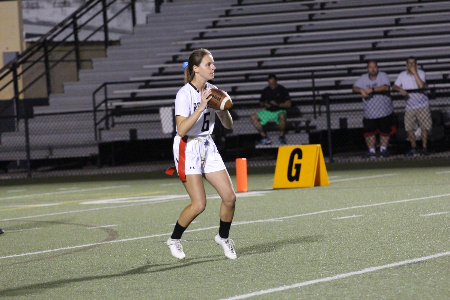 Quarterback Lauren King ('18) shuffles around before finding an open Emily Kemp ('20).