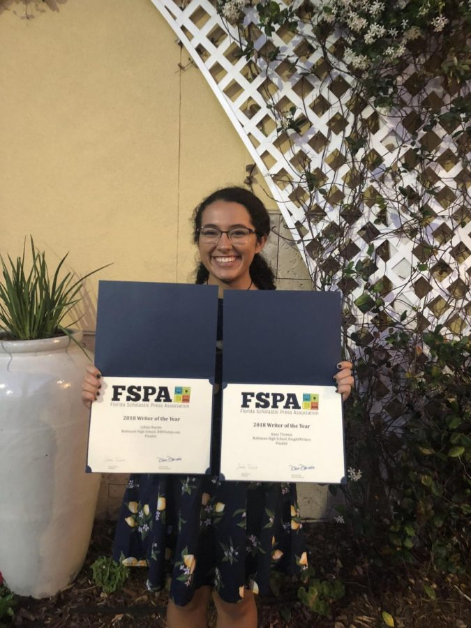 News+Editor+Lillian+Martin+%28%2718%29+poses+with+award+certificates+at+the+FSPA+banquet+in+Orland.+There%2C+Martin+was+recognized+as+a+finalist+for+the+2018+Writer+of+the+Year+award.
