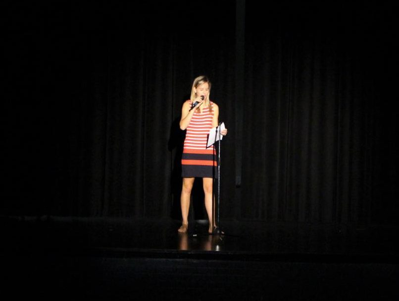 Carolina Cassedy ('18) speaks in front of Robinson students prior to the performance of