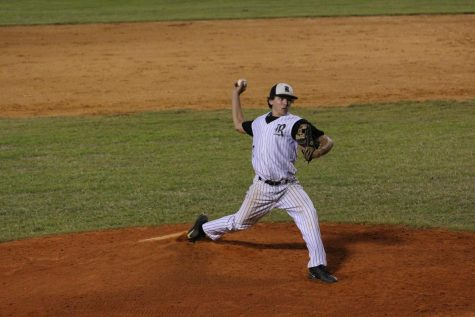 Mikey Swanson ('19) winds up to pitch.
