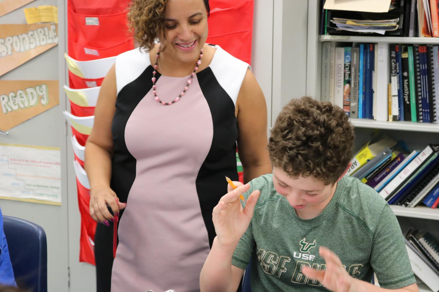 Ms. Charley-Sale assists a student** with math work