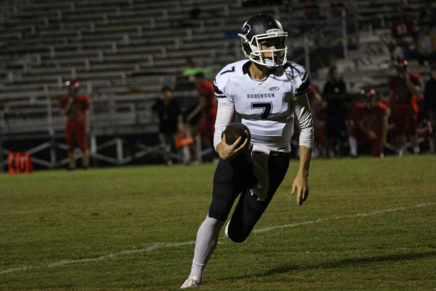 Quarterback Kobe Copple ('19) runs the ball into the end zone. Copple ran for two touchdowns throughout the night