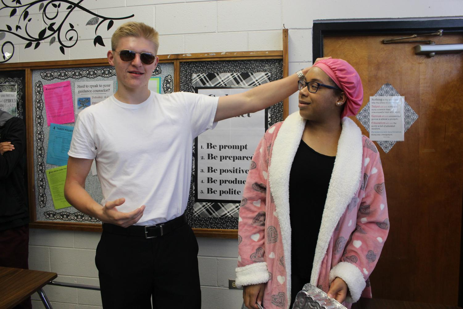 Nicholas Rogers ('20) and Shayla Estelle ('20) pose as their meme day characters.