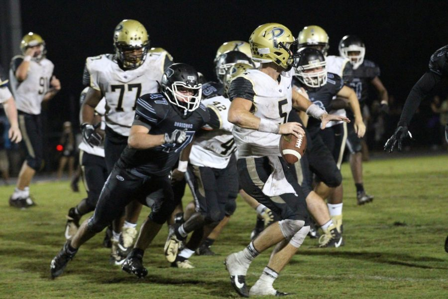 Jo Jo Muffoletto ('19) helps sack Plant's quarterback in the South Tampa matchup last Friday.