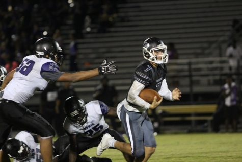 Robinson overcomes Spoto 28-24 in close game