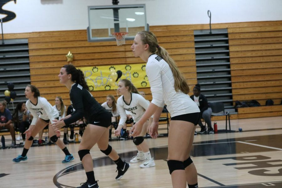 Kristin Werdine ('19) and her teammates get ready as the ball is being served.