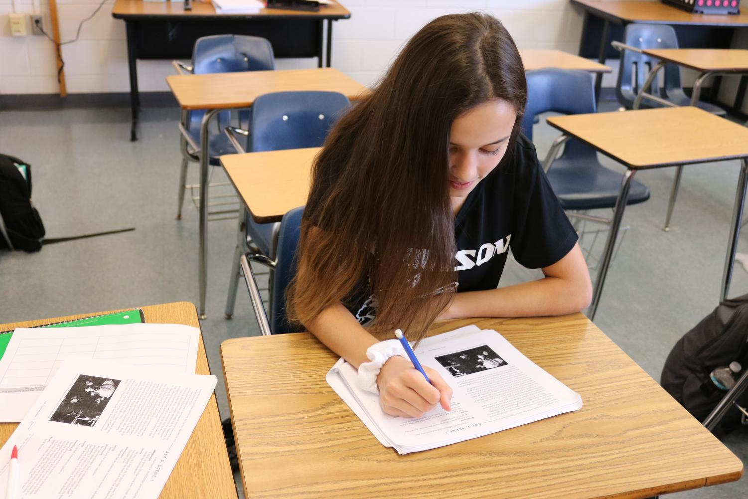 Macey Hatton ('19)  works on an assignment.