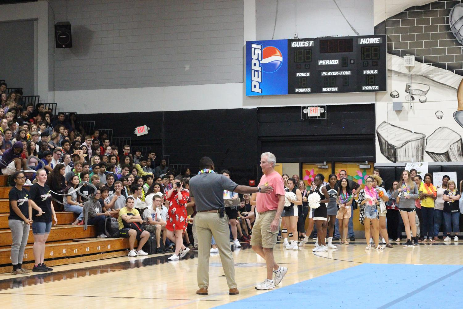 Principal+Bhoolai+dedicates+a+moment+of+the+pep+rally+to+honor+Bill+Gondridge+going+into+retirement.+The+student+body+wishes+him+a+goodbye+after+his+many+years+of+teaching+at+Robinson.