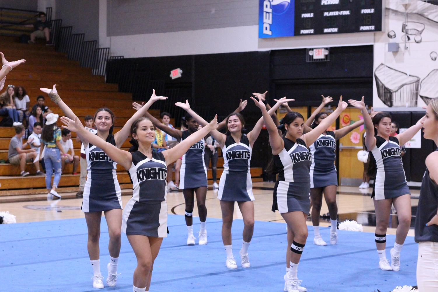 Performing+their+game+day+routine%2C+the+Robinson+cheerleaders+start+off+the+first+pep+rally+of+the+year.