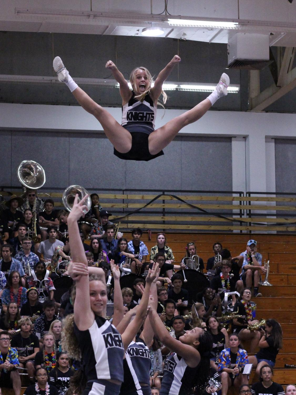 Flyer+Alison+Quigley+%28%2722%29+during+a+mid-air+stunt+with+the+Robinson+knights+cheer+team.