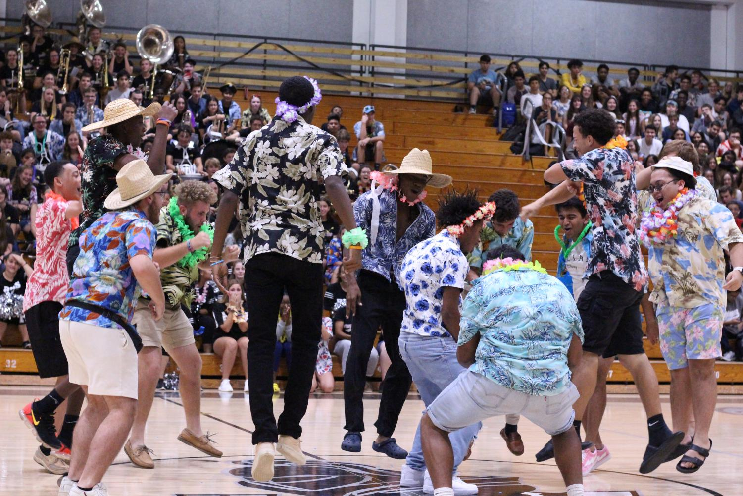 Following+the+cheerleaders%27+excitement%2C+Robinson%27s+spirit+boys+perform+their+Hawaiian+luau+dance.