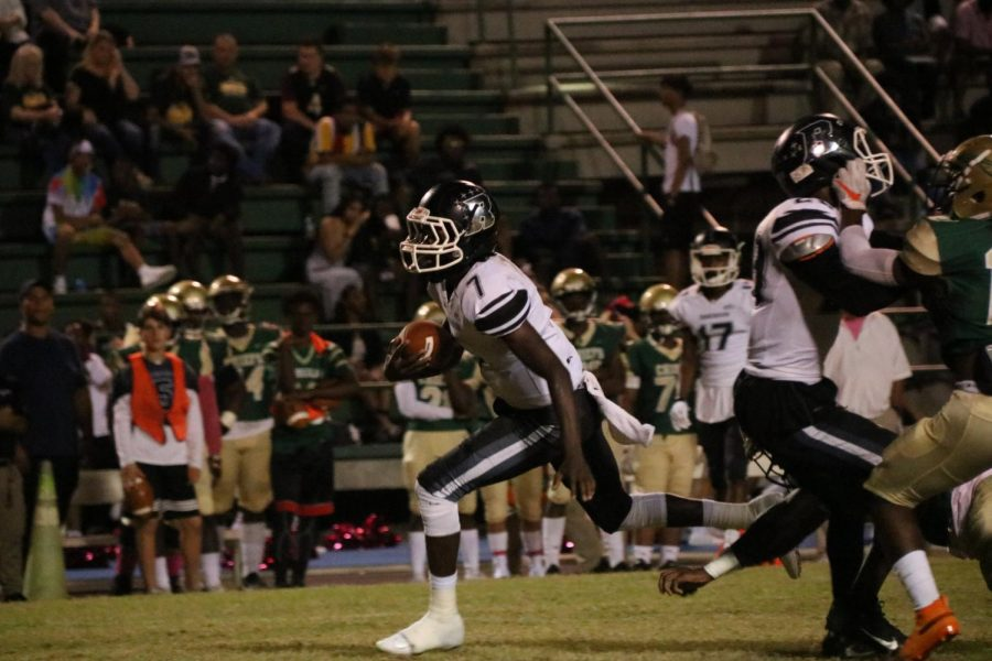 Quarterback Rickeem Parks ('22) scrambles out of the pocket.