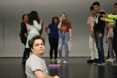 Charles Davidson works with the cast to craft a scene from his play, Dystopia: A Teen Parody.