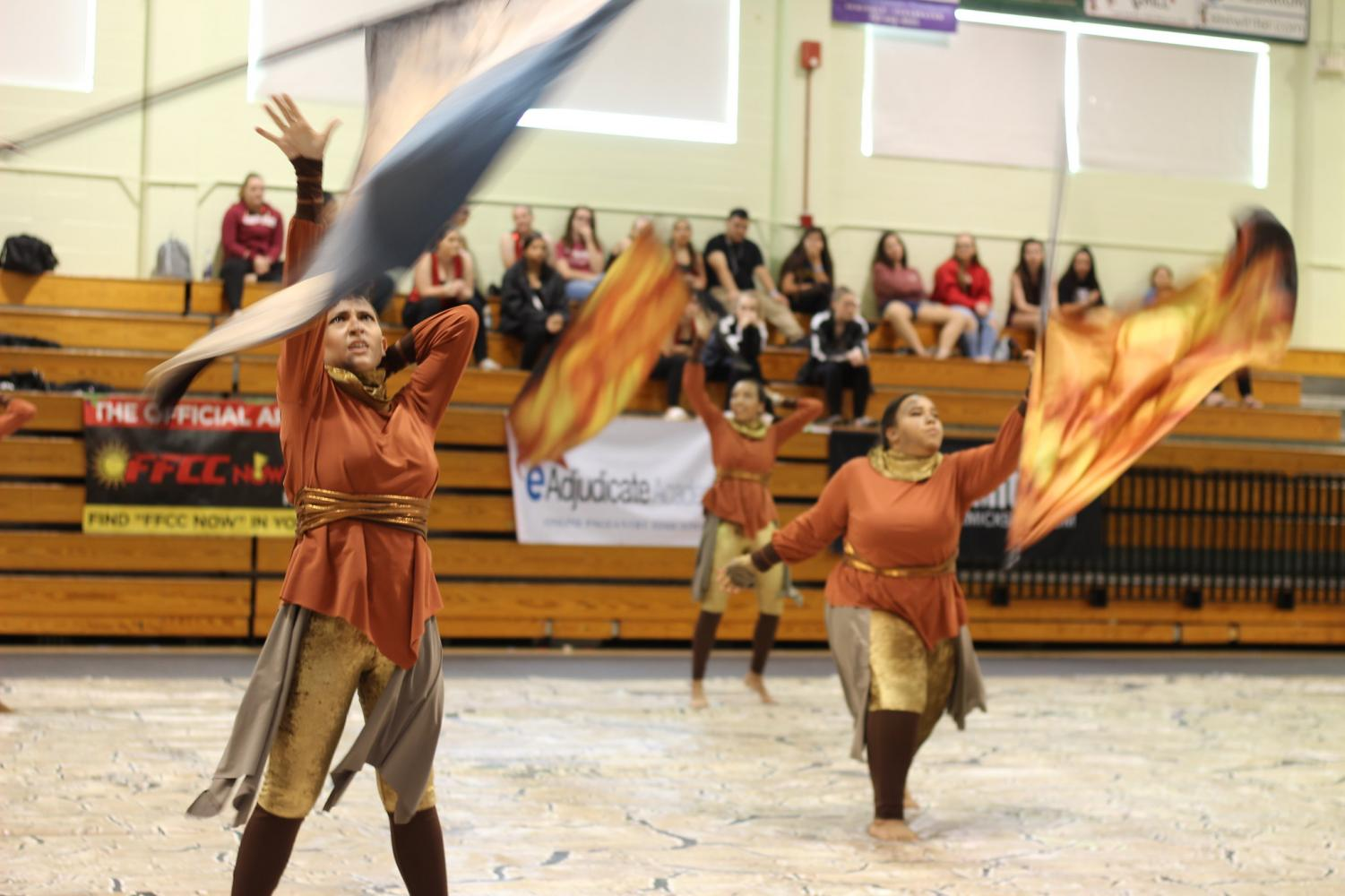 Members of the Robinson Colorguard perform a flag routine for a competition.