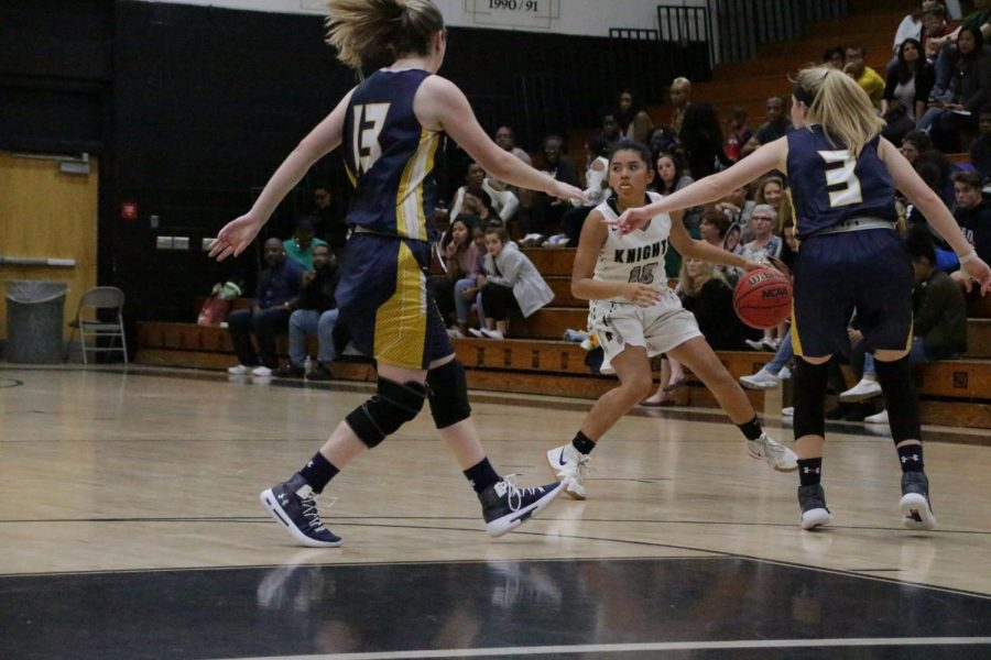 Sophia Guillermo ('21) brings the ball to the three-point line.