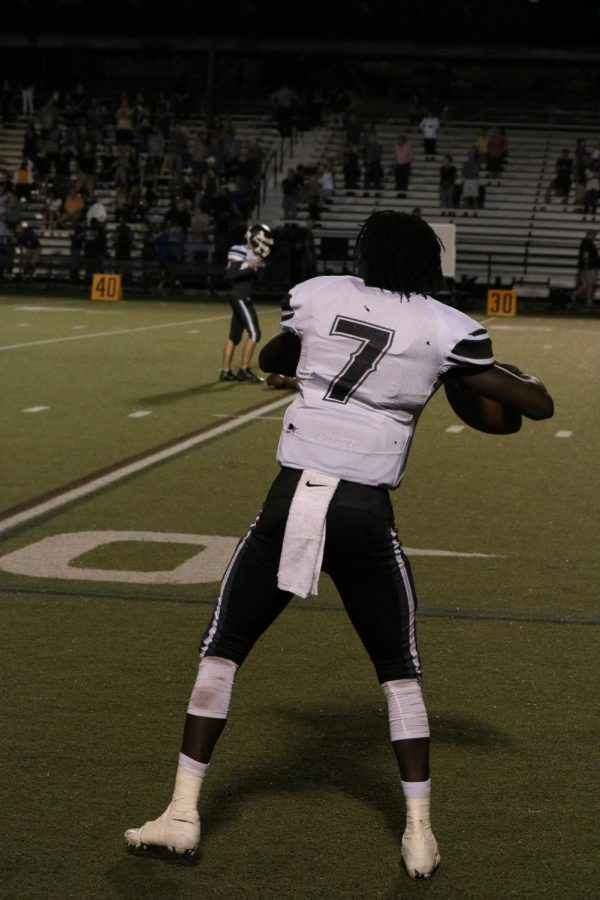 Quarterback Rickeem Parks ('22) warms up before the Plant rivalry game.