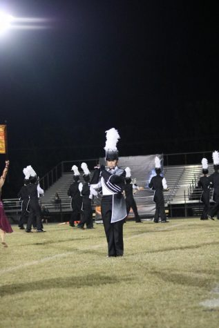 Samantha Garcia ('20) takes the field to perform the halftime show during the Newsome football game.