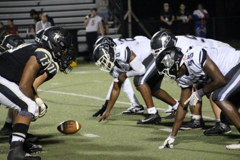 The Knights line up at the line of scrimmage for another play against Plant.