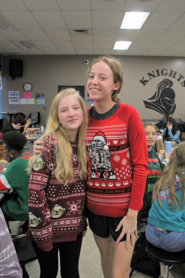 Lauren Yoakmun ('23) and Kelsi White ('23) show their different holiday sweaters.