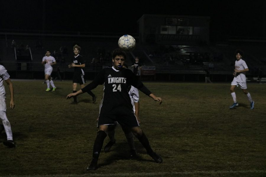 Gabriel Elias ('22) uses his head to pass the ball.