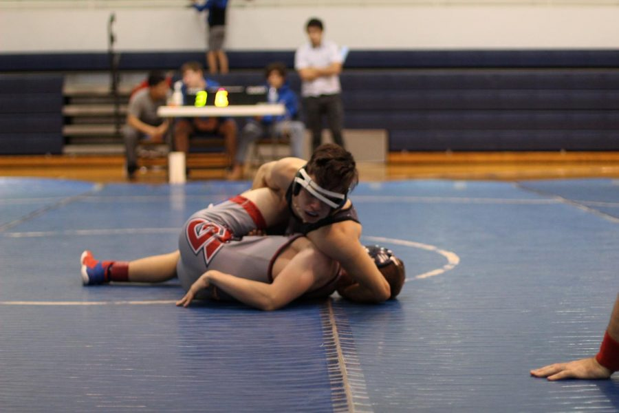 Thomas+Green+%28%2721%29+puts+Freedom%27s+132+pound+weight+wrestler+in+a+half+nelson+to+score+a+three+point+near+fall.