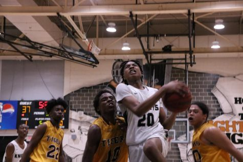 Treyshawn Howard ('22) battles through the Middleton defense to attempt a layup.