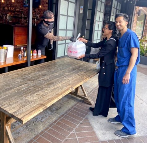 Healthcare workers receive free food from a restaurant in Los Angeles.