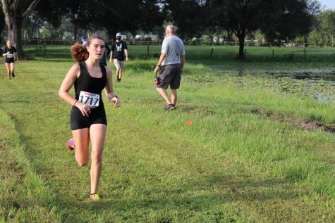 Shea Dingle ('21) runs in a race at the Mary Help meet on August 29.