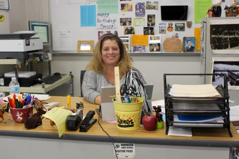 Melissa Mousseau sitting  behind her desk.