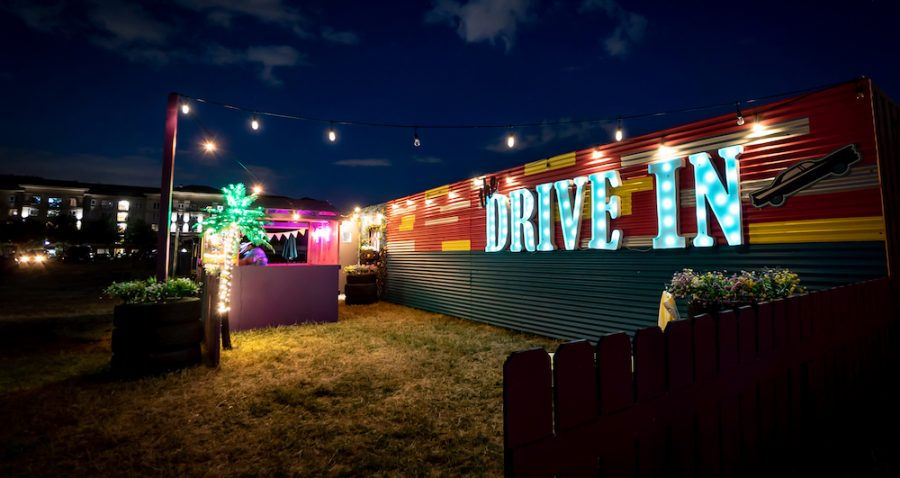A neon drive-in sign at the back of the plot of land at Armature Works where the makeshift drive-in theatre is located.