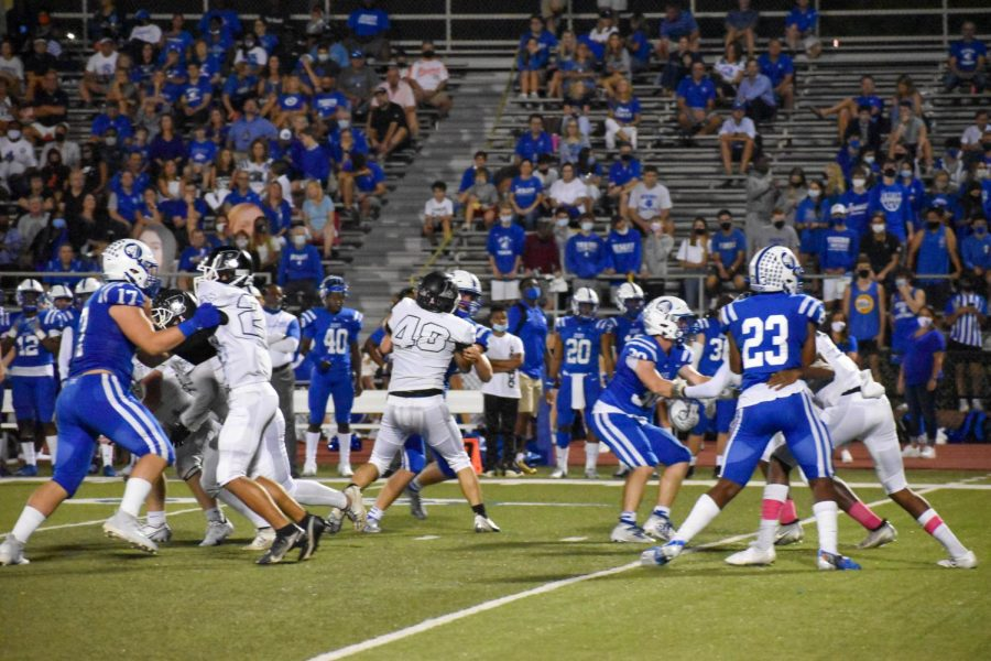 Robinson Knights play against the Jesuit Tigers, where spectators can clearly be seen in the background.